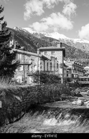 Spring in a mountain creek village of Italian alps. - Stock Photo