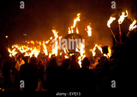People marching along road for the East Hoathly Bonfire night; East Sussex, England - Stock Photo