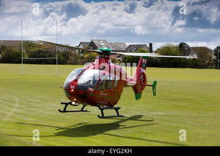UK, Wales, Gwynedd, Towyn, Wales Air Ambulance taking off from Tywyn playing fields - Stock Photo
