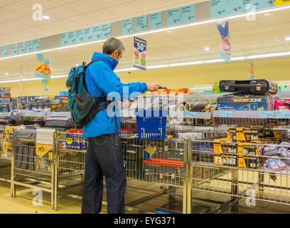 Mature man shopping in Aldi store. UK
