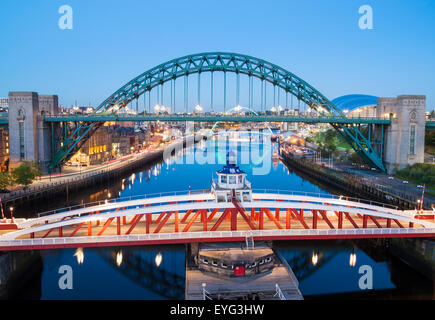 Newcastle Quayside and Tyne bridge at dusk. Newcastle upon Tyne, England. UK - Stock Photo