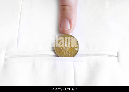 saved penny is penny earned proverb representing coin in jacket pocket - Stock Photo