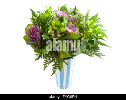 Bouquet with different kind of flowers in blue white vase over white - Stock Photo
