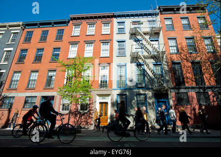 Cycling In Front Of Some Apartments Buildings In The West Village, Manhattan, New York, Usa - Stock Photo