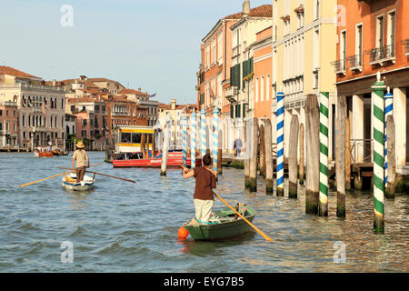 Venetians with traditional rowing boats - Stock Photo