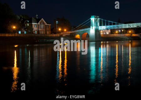 Darkness on the River Trent at Wilford Suspension Bridge, Nottingham England UK - Stock Photo