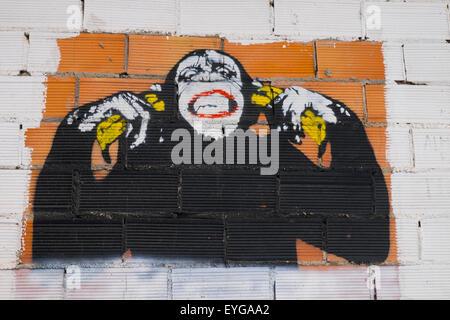 Example of urban street art  - graffiti image of a chimp using spray paint - Stock Photo