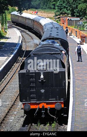 Steam Locomotive Ivatt Class 4 2-6-0 number 43106 approaching the railway station, Arley, England, UK. - Stock Photo