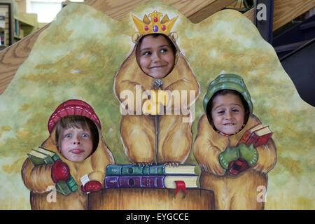 Punxsutawney, United States, children put their heads through a photo wall - Stock Photo