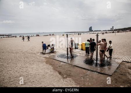 men taking a shower in the barceloneta beach - Stock Photo