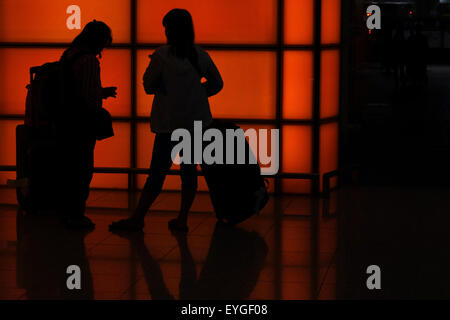 Hong Kong, China, Silhouette travelers at Chek Lap Kok Airport - Stock Photo