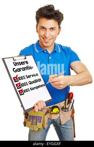 Craftsman offering German guarantee 'Unsere Garantie: 100% Service, Qualitaet, Kompetenz' (Our guarantee: 100% service, - Stock Photo