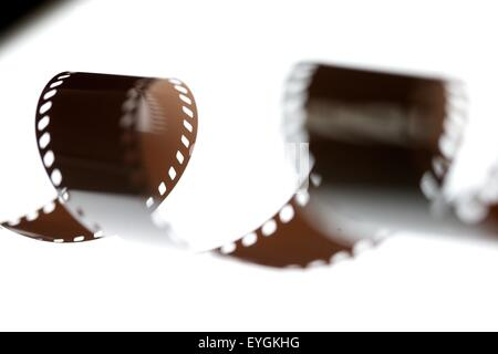 35mm film spool on a light box in a film processing lab - Stock Photo
