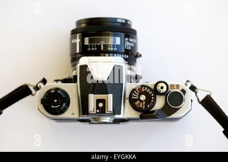 looking down on the controls of a Nikon FM2 manual traditional SLR film camera and standard 50 mm lens - Stock Photo