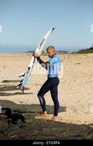 Australian professional surfer Mick Fanning on the beach at the 2015 J-Bay Open surfing event in Jeffreys Bay - Stock Photo