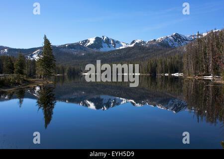 Sylvan Lake mirroring Top Notch Peak in Yellowstone National Park - Stock Photo