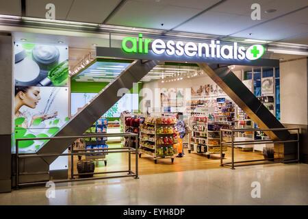 South Miami Florida International Airport MIA terminal concourse gate area inside interior shopping Air Essentials - Stock Photo