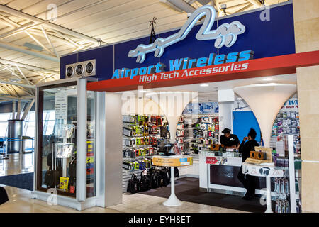 New York Queens John F. Kennedy International Airport JFK inside interior terminal concourse gate area shopping - Stock Photo