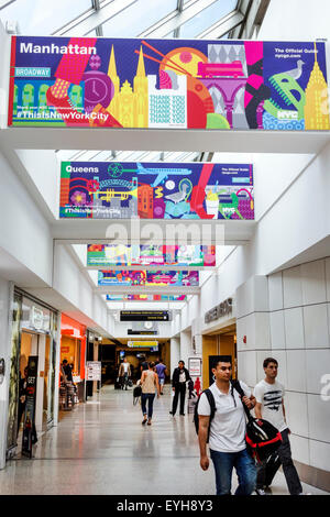 New York Queens John F. Kennedy International Airport JFK inside interior terminal concourse gate area promotion - Stock Photo