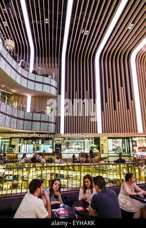 Madrid Spain Europe Spanish Recoletos Salamanca Calle de Goya Platea Madrid shopping Hispanic man woman couples - Stock Photo