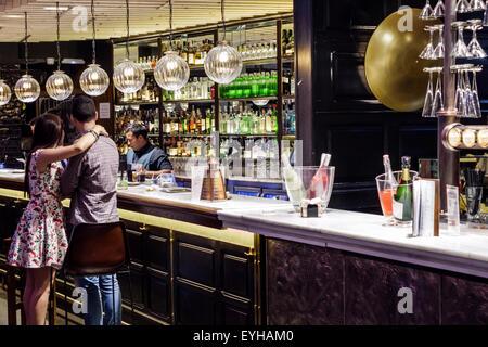 Madrid Spain Europe Spanish Recoletos Salamanca Calle de Goya Platea Madrid shopping bar Hispanic man woman couple - Stock Photo