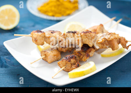 Indonesian chicken satay skewers with curry , peanut ...