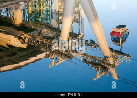 reflections of Emirates Air Line Cable Car ride between Greenwich Peninsula and the Royal Docks entering station, - Stock Photo