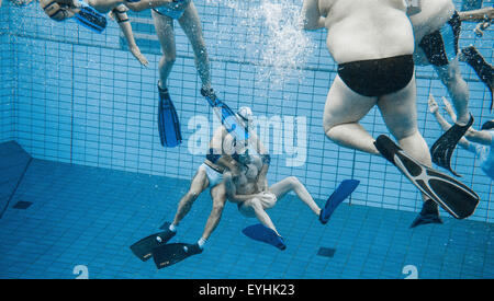 Berlin, Germany. 29th July, 2015. Swimmers play underwater rugby in the public swimming pool at the Olympic stadium - Stock Photo