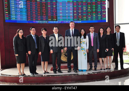 Ho Chi Minh City, Vietnam. 30th July, 2015. British Prime Minister David Cameron (5th, L) visits the Stock Exchange in Ho Chi Minh City, Vietnam, July 30, 2015. David Cameron is on a visit to Vietnam from July 29 to 30. Credit:  VNA/Xinhua/Alamy Live News