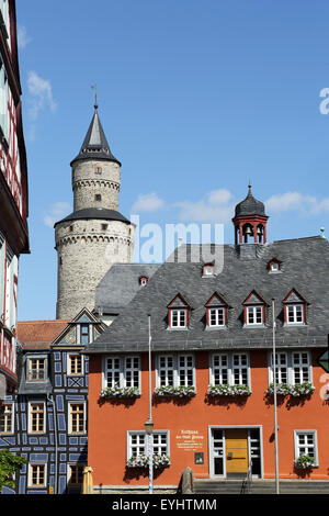 The Hexenturm ('Witches Tower) and town hall in Idstein, Germany. - Stock Photo