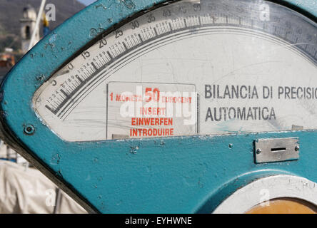Old coin operated weigh scale in Italy - Stock Photo