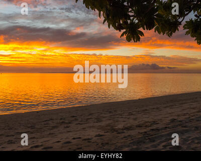 Flic en Flac, Mauritius. La Pirogue tourist resort. Golden sunset. - Stock Photo