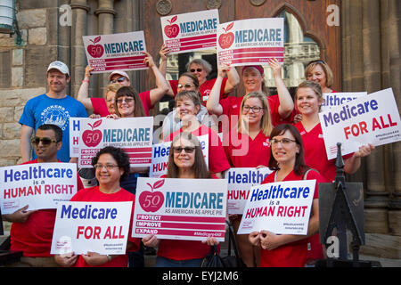 Detroit, Michigan, USA. 30th July, 2015.  Nurses, union members, and retirees rally to improve Medicare, as they - Stock Photo