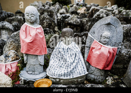 Small jizo statues at famous Daitokuji (Daitoku-ji) Temple. Buddhist zen temple of Rinzai school. - Stock Photo