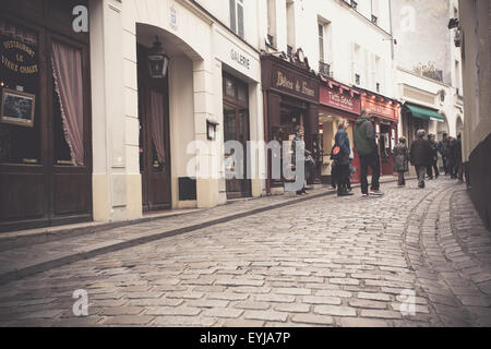 Vintage filter effect street view of Montmartre in Paris France - Stock Photo