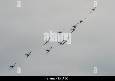 Eleven World War Two Spitfires flew together at the airshow in formation, from Duxford an airfield at the heart - Stock Photo