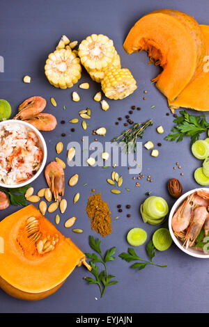 Raw ingredients for vegetable and seafood soup shot from above - Stock Photo