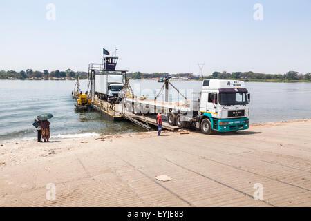 Lorry disembarking from the Kazungula Ferry in Botswana, a pontoon ferry across the Zambezi River between Botswana - Stock Photo