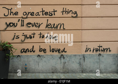 love written on the wall of the city - Stock Photo