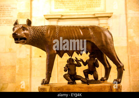 The Capitoline She-Wolf bronze statue featuring the mythical twins Romulus and Remus in the Capitoline Museum Rome - Stock Photo
