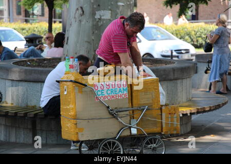 Ice Cream seller in Tbilisi, Georgia. The trolley is made from an old pushchair - Stock Photo