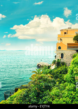 Turquoise sea and blue sky. Beautiful mediterranean landscape, French riviera, France. Retro style colored photo - Stock Photo