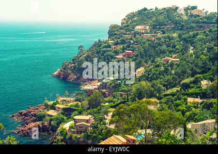 Beautiful mediterranean landscape, view of village and coastline, french riviera, France. Vintage style toned photo - Stock Photo