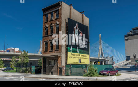 Old Building near The TD Garden with  Boston Celtics Basketball Player on a billboard with the Zakim Bridge in the - Stock Photo
