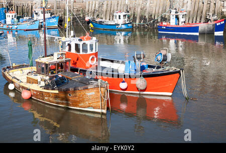 Fishing boats in the harbour at West Bay, Bridport, Dorset, England, UK - Stock Photo