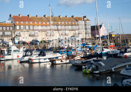 Moored boats in the harbour at West Bay, Bridport, Dorset, England, UK - Stock Photo