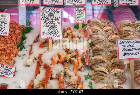 Freshly caught sea food on display at the Fish Counter at Pike Place Market , Seattle , Washington State , USA - Stock Photo