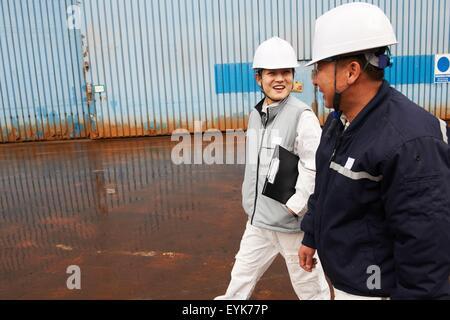 Workers walking through shipyard, GoSeong-gun, South Korea - Stock Photo