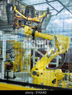 Car body welding robots in car factory - Stock Photo