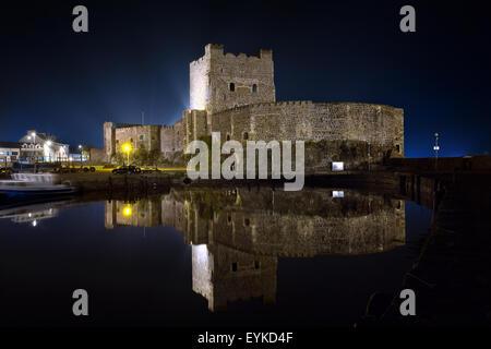 Carrickfergus Castle by night . Belfast area, Northern Ireland - Stock Photo
